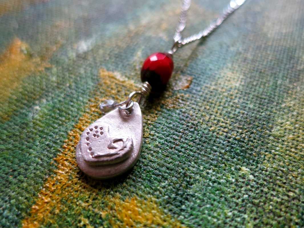 Silver clay hand decorated heart pendant by Perfidious Jewellery