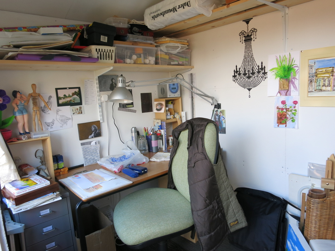 An art studio in a garden shed! Great craft room idea with photos showing how perfect it is.